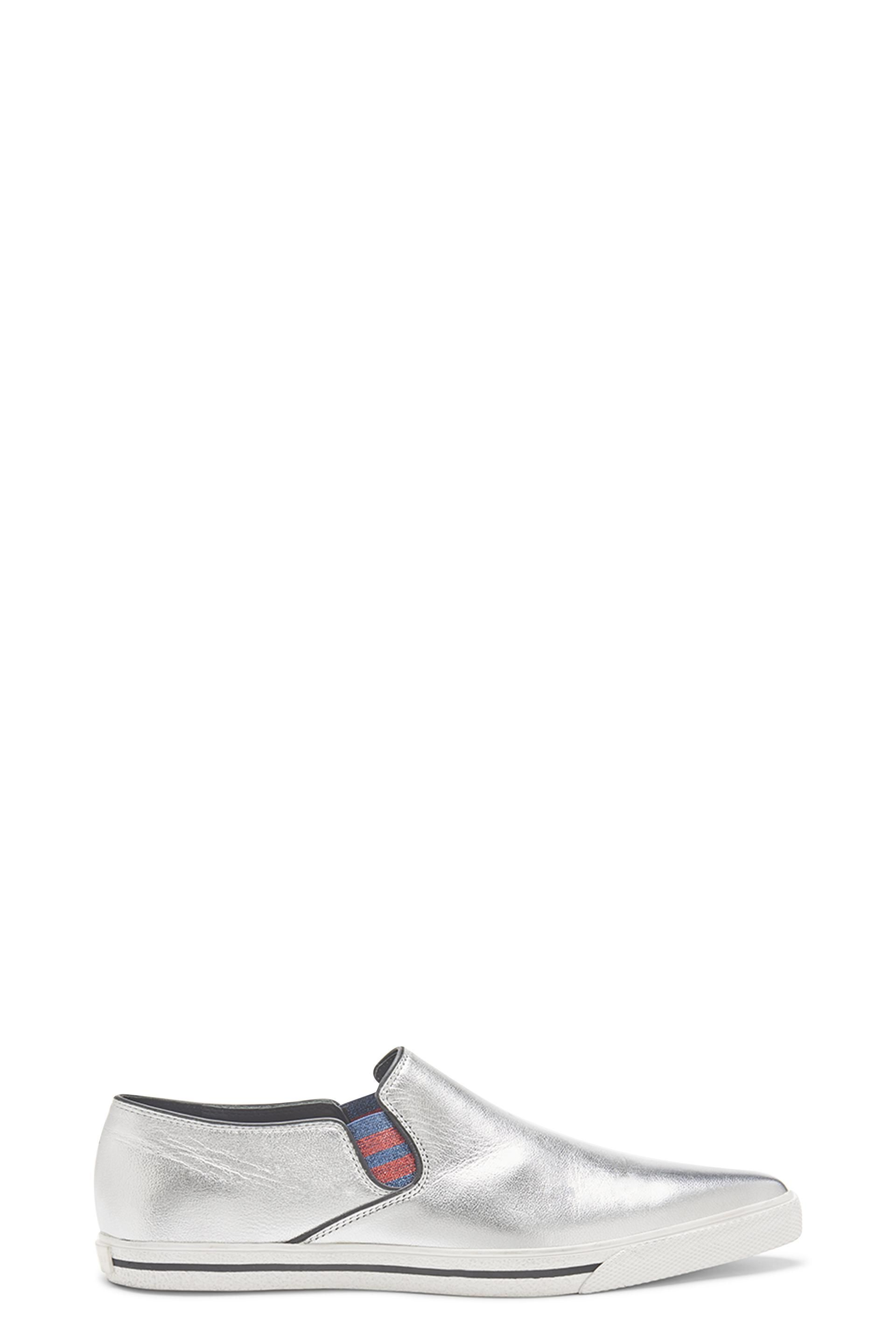 The Marc Jacobs Delancey Slip On Sneaker is crafted from smooth Vachetta leather with a metallic foil finish. Slip on construction with elastic gores and a rubber sole give this style comfort. Whole sizes only 35-41. 100% Calf Leather bRBrMade In Italy