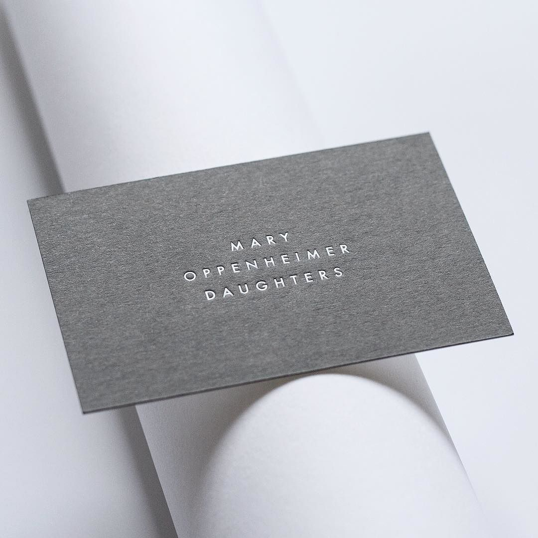 business cards white foil on dark grey colorplan simple but beautiful white debossing on