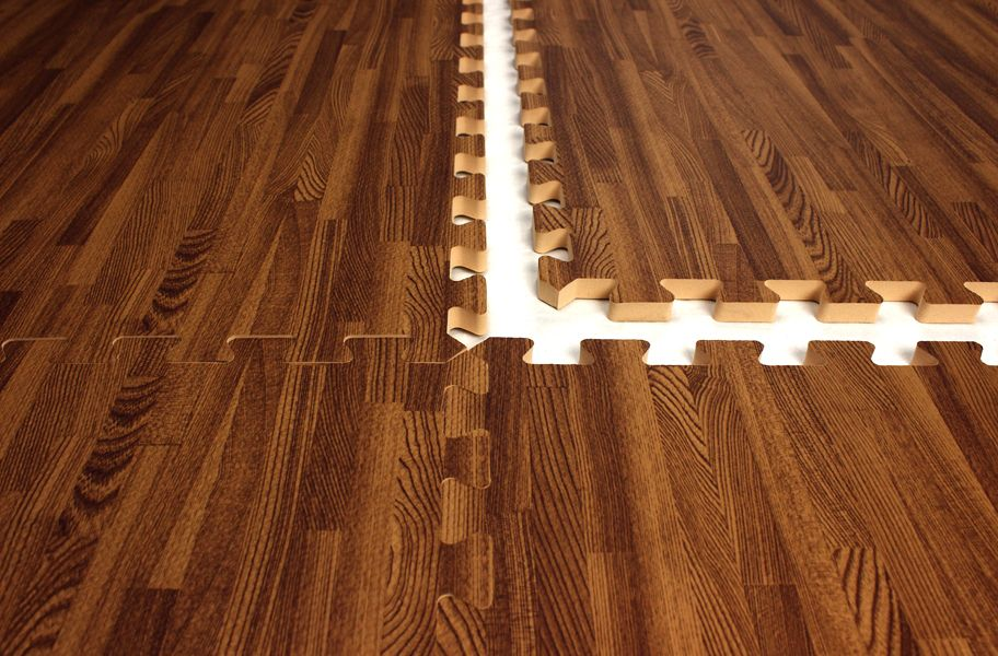 Interlocking foam mats that look like wood great for a for Rubber hardwood flooring