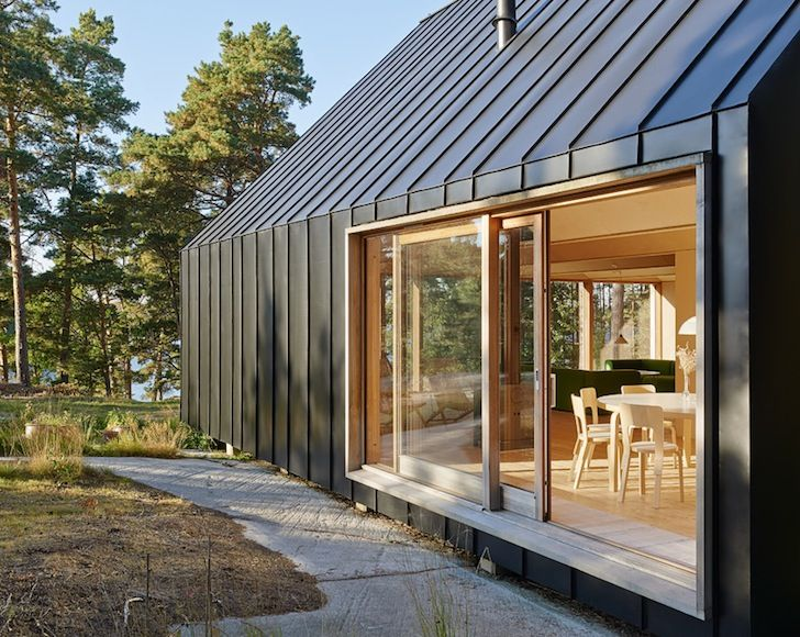 Modern metal clad house husar is nestled high on a for Modern metal building