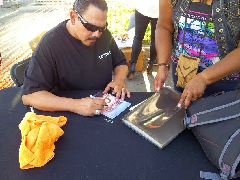 Emilio Rivera (SOA, Mayans MC) signing pics for Fan Page prizes - 2014 Monster Car and Bike Fest. - Rancho Cucamonga, CA