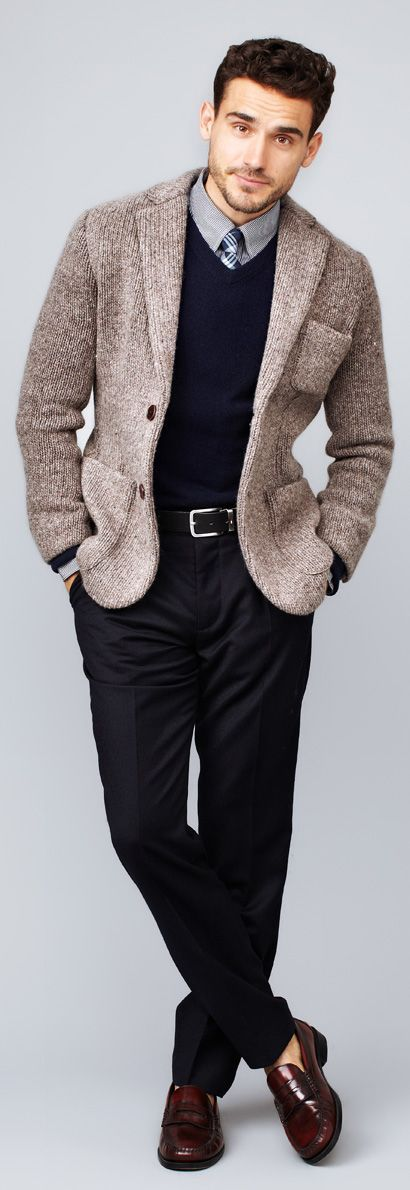 Consider pairing a brown knit blazer with black dress pants for a sharp, fashionable look. Dark red leather loafers will contrast beautifully against the rest of the look.   Shop this look on Lookastic: https://lookastic.com/men/looks/blazer-v-neck-sweater-long-sleeve-shirt-dress-pants-loafers-tie-belt/5050   — Grey Long Sleeve Shirt  — Navy Plaid Tie  — Navy V-neck Sweater  — Brown Knit Blazer  — Black Leather Belt  — Black Dress Pants  — Burgundy Leather Loafers