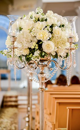 Regal and elegant, these candelabras make the perfect decor for Disney's Wedding Pavilion #white #flowers #wedding