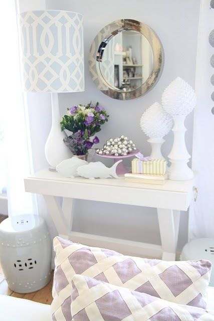 pretty pastels.  lovely lavender lattice pillows, silver mirror, x base table and white ceramic accents.