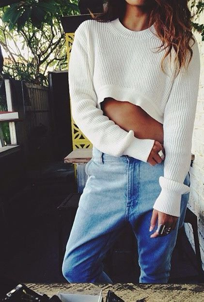 crop top long sleeve knit sweater with blue denim jeans.