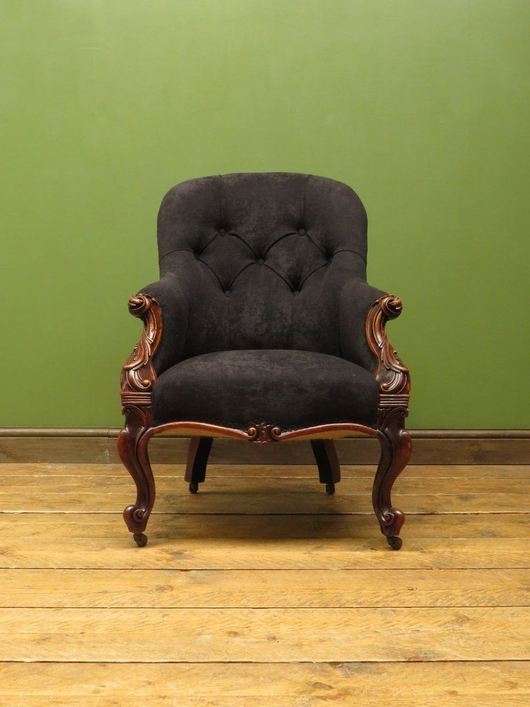 Antique newly upholstered victorian button back armchair