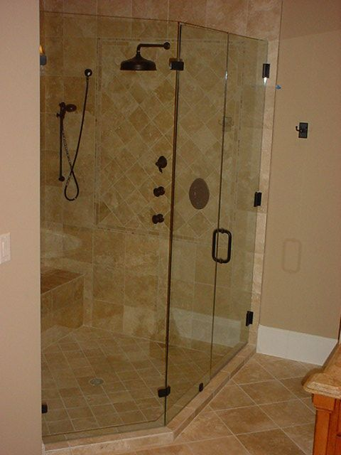 And, of course, a glass #shower enclosure with a rain shower head ...