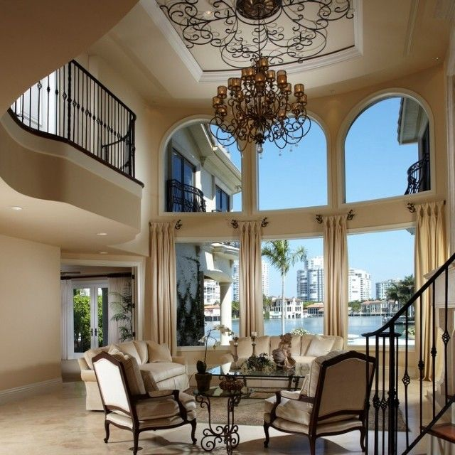 Beautiful grand living room with big windows. Such a ...
