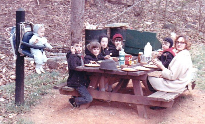 """""""Our family of 6 kids did a lot of traveling by VW bus. This shows the youngest brother """"hanging"""" around. I have a bunch more awkward family shots but this one just cracks us all up."""" (submitted by Katrina)"""