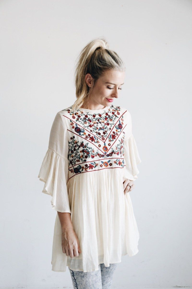 808a5dc153e Cream embroidered top with floral detail. Loose belle sleeves and a slip  underneath the bottom. Made from cotton and polyester. Model in a small.
