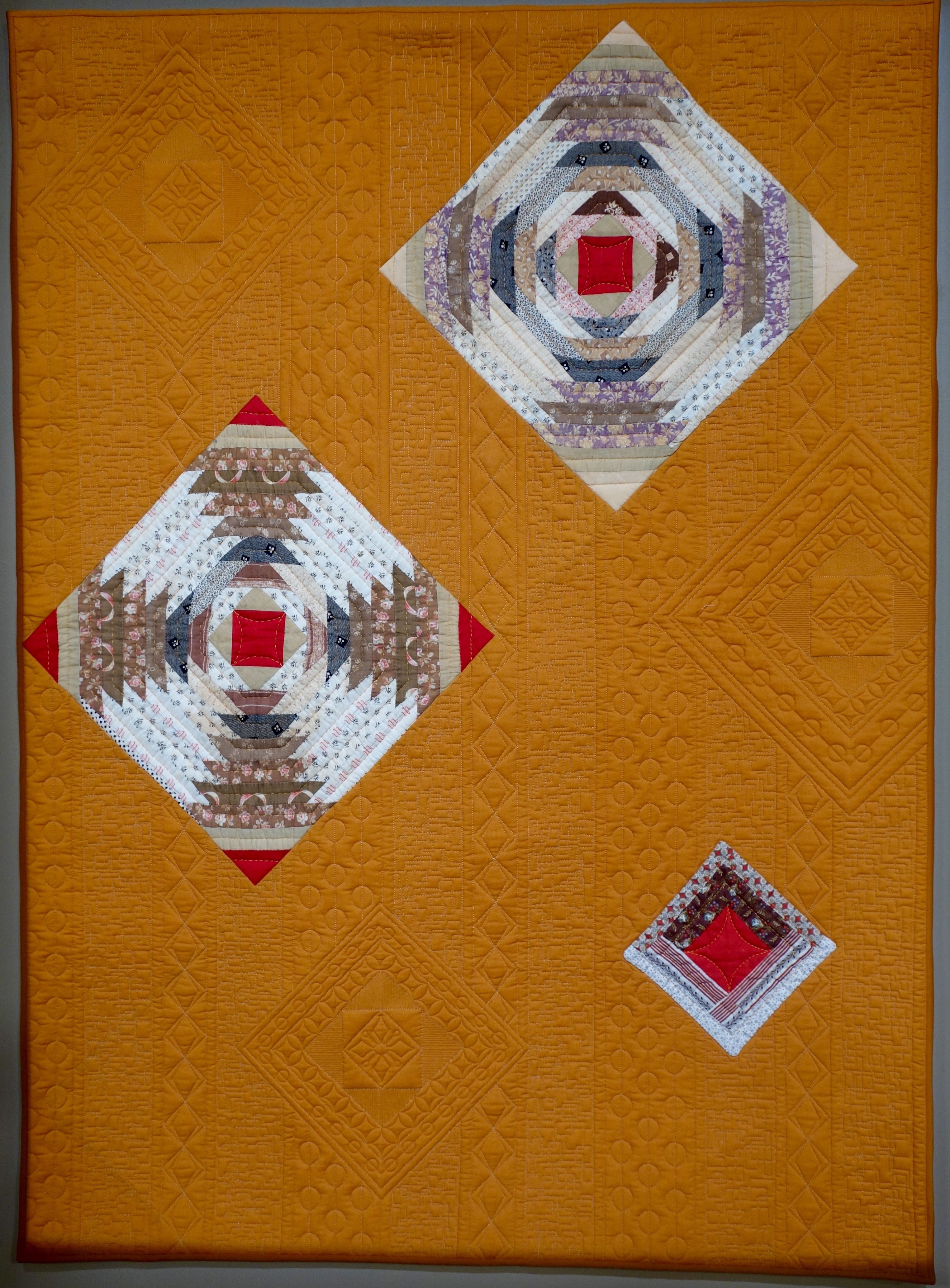 """""""Ojo de Dios"""" made  by Mary Kerr and quilted by Candice West"""