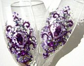 Wedding toasting flutes, hand decorated with purple fleur de lis on a silver metal leaves background