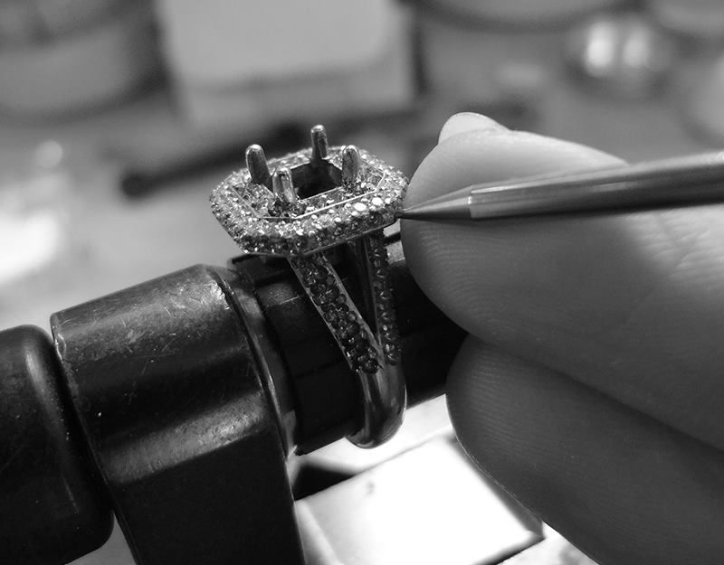 After all of the bright-cuts are made and the initial prongs are formed, it is time for diamond setting. Each diamond is snapped into place and the prongs are pushed over the stone. After setting, the jeweler uses a beading tool to give the little prong a perfect spherical shape which also burnishes the prong making it harder.