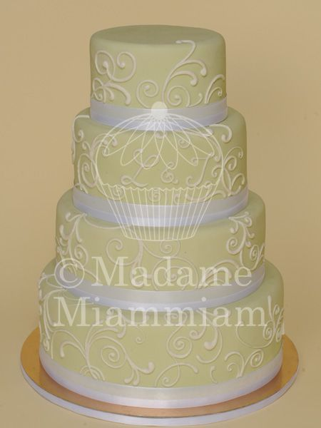 wedding cake with ornaments in yellow and white