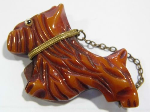 A-Vintage-Bakelite-carved-dog-brooch-with-metal-collar-and-chain-leash