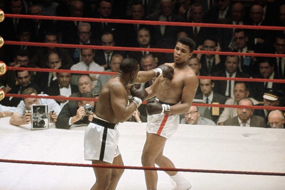 Cassius Clay, right, as he was known at the time before changing his name to Muhammad Ali, in action against Sonny Liston during the heavyweight title fight in Miami Beach, Fla., Feb. 25, 1964.