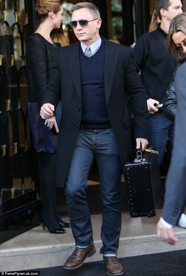 You know you don't have a real licence to kill  Daniel Craig looks stuck in 007 character as he leaves Paris hotel is part of Fashion for men over 40 - James Bond actor Daniel Craig's professional life appears to be merging with his personal life as his fashion choices match up to those of 007 as the actor goes about his business in Paris