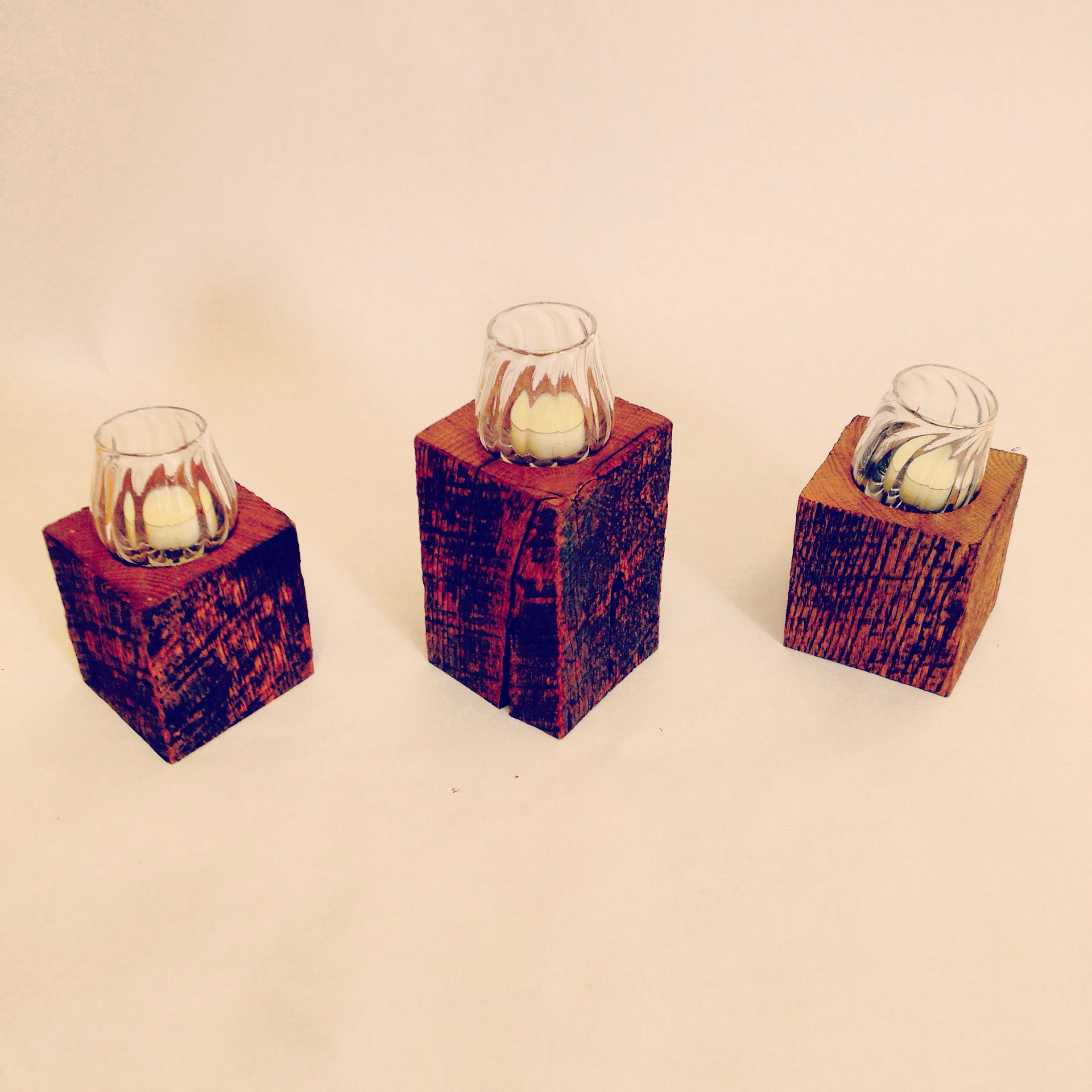Reclaimed chestnut barn wood pillar candles and hand blow votives. All made in RI.