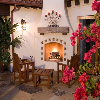 Use mexican tile to create a unique and beautiful mexican for Spanish style outdoor fireplace