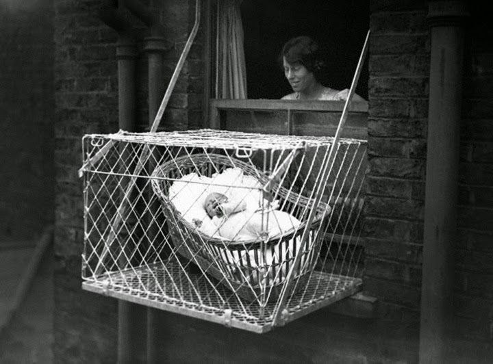 Incredible Pictures Of Baby Cages Hanging Outside London Apartment Windows 1930s Baby Pictures Window Baby London Baby