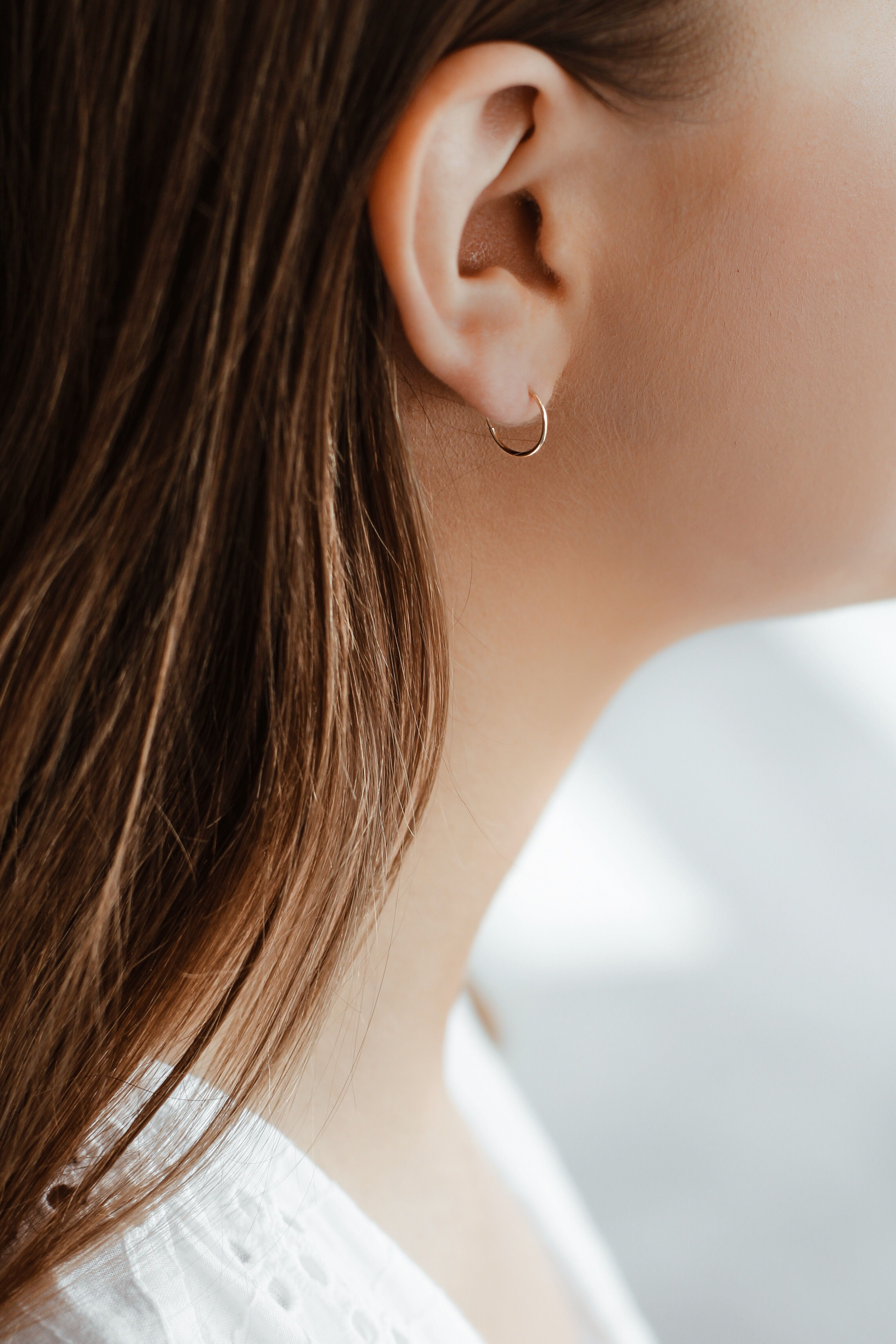 a87ce7e4f Those mini hoops made of 14k solid gold look and feel great. Versatile,  subtle