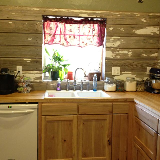 Our kitchen... Old barn wood for backsplash, butcher block countertops made from oak, sweet gum ...