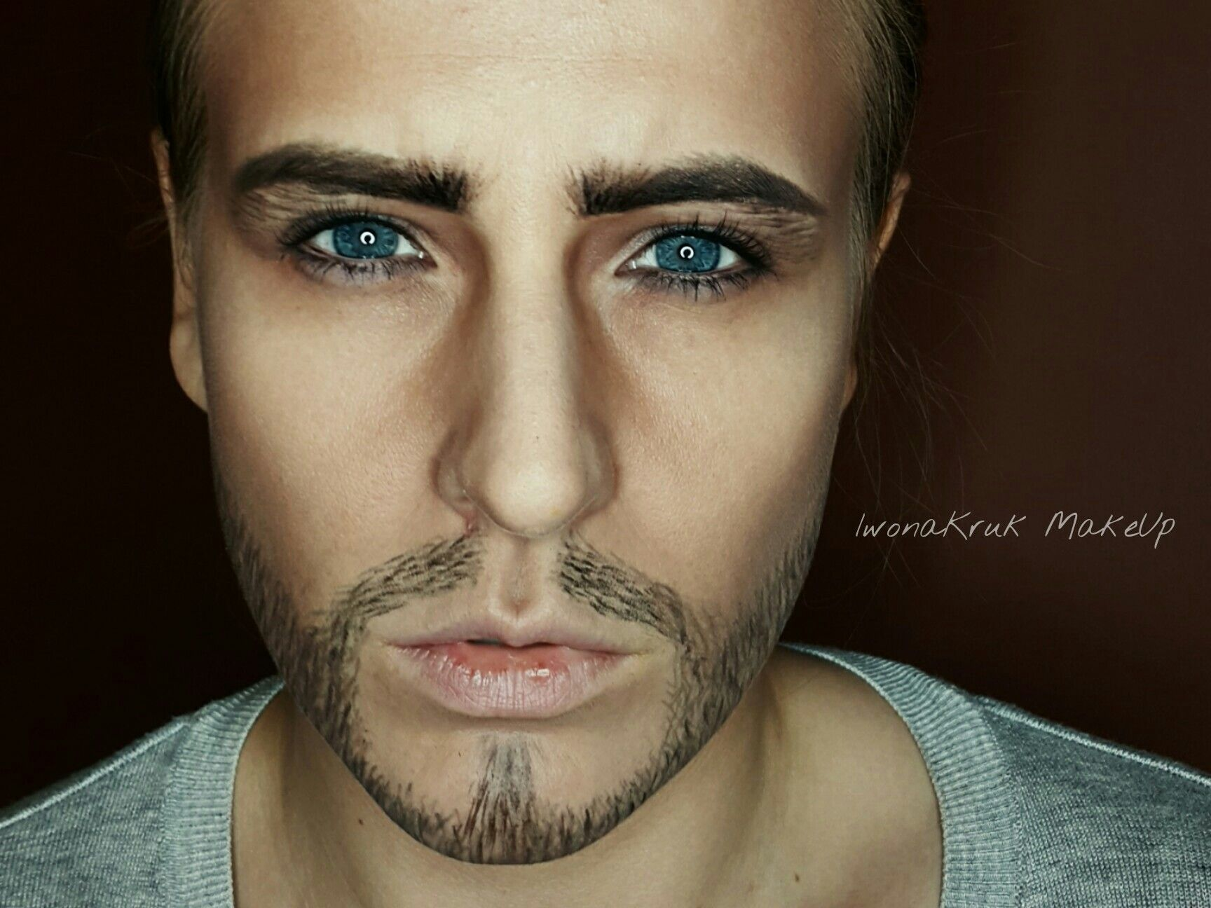 Halloween transformation of woman  for men. Blue eyes , strong eyebrows , moustache.