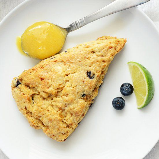 These scones are flaky, buttery, & have bursts of sweet juicy blueberries. The lime curd, whoa, it just goes with the blueberries!
