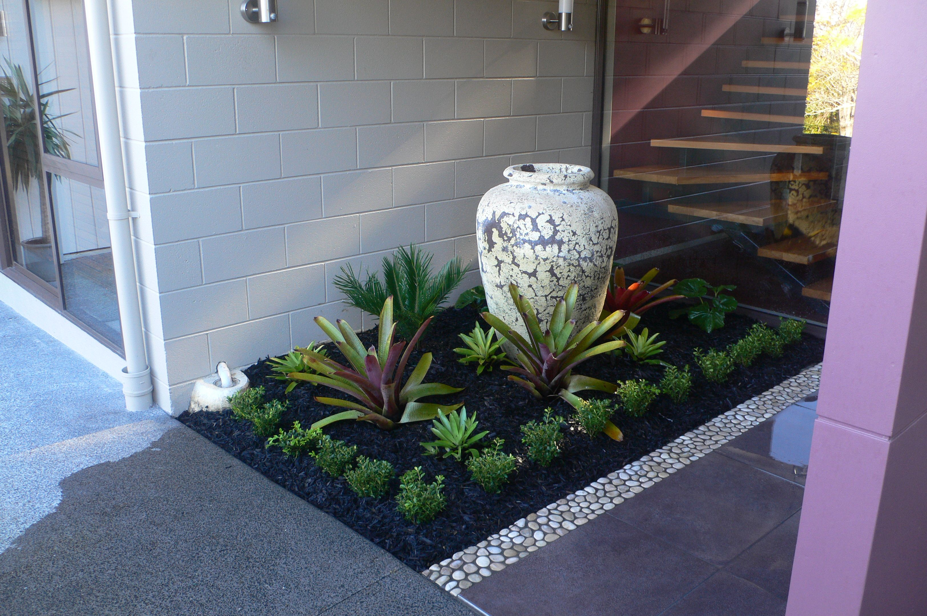 A Small Garden At A Front Entrance Designed And Implemented By