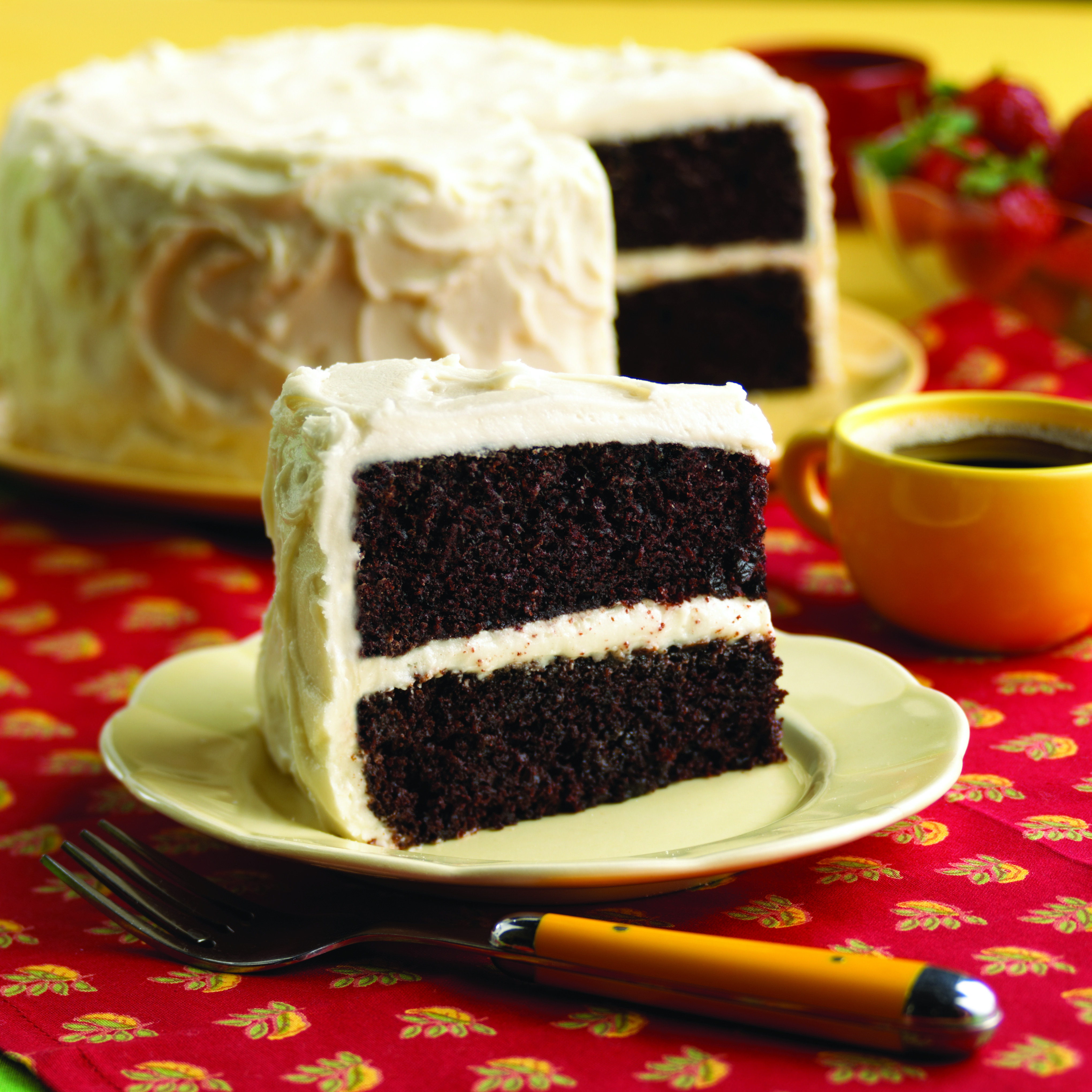 Deep, dark #chocolate #cake under brilliant white sour #cream frosting everyone will want to save room for this rich, dramatic #dessert