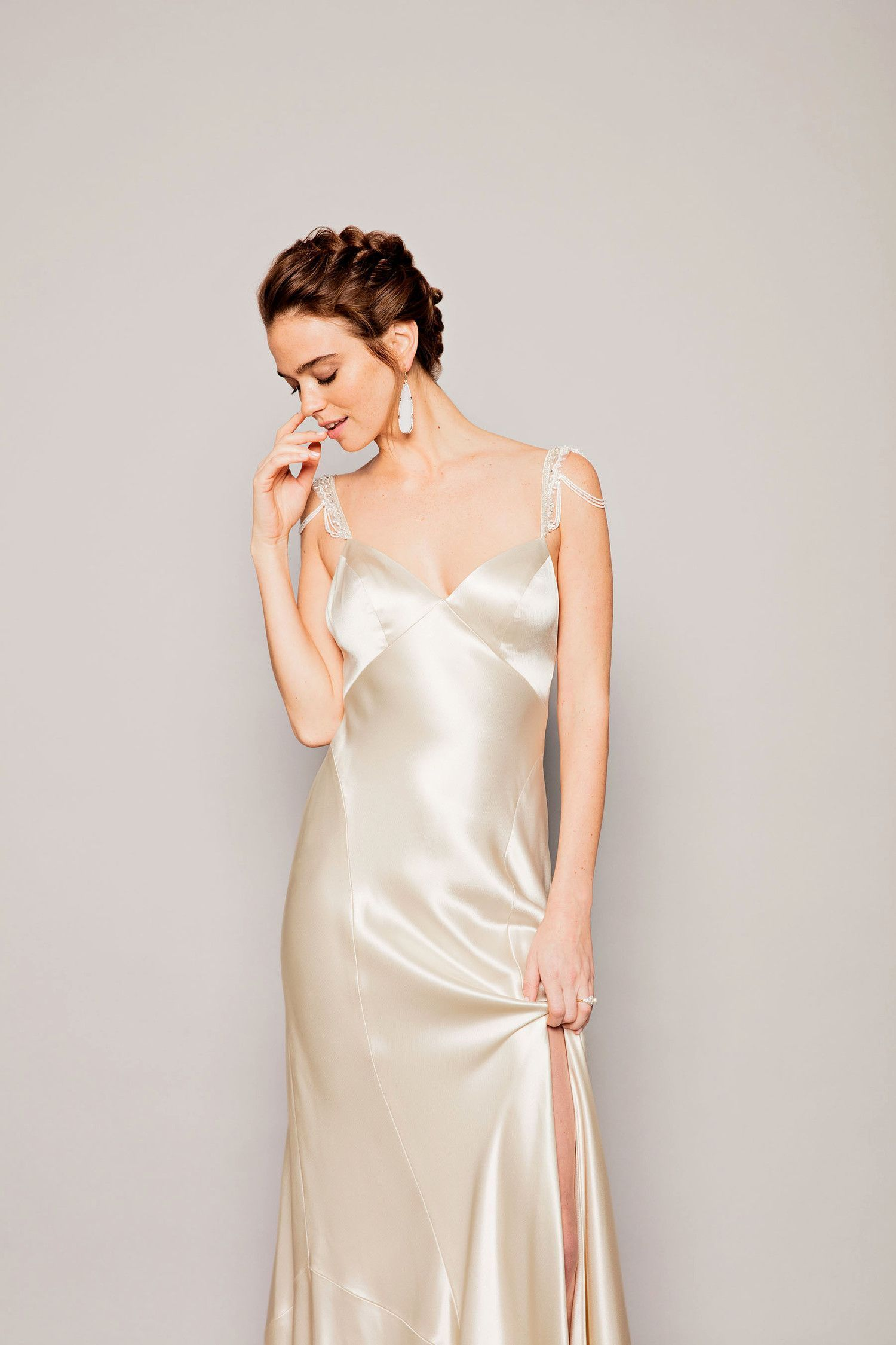 Hello, gorgeous. If a sophisticated affair is on your calendar, slip into Watters' '40s-inspired charmeuse Geneva gown with crystal- and pearl-beaded Keane straps. A loose braid only adds to the romance.    The Details: Watters Geneva gown and Keane straps, gown, $2,225; and straps, $380, Lovely Bride, 626-345-5828. Sylva & Cie agate drop earrings, $13,750, Stanley Korshak, Dallas, 214-871-3600. Mateo New York diamond-and-pearl ring, $3,250, mateonewyork.com. #loosebraids Hello, gor #loosebraids