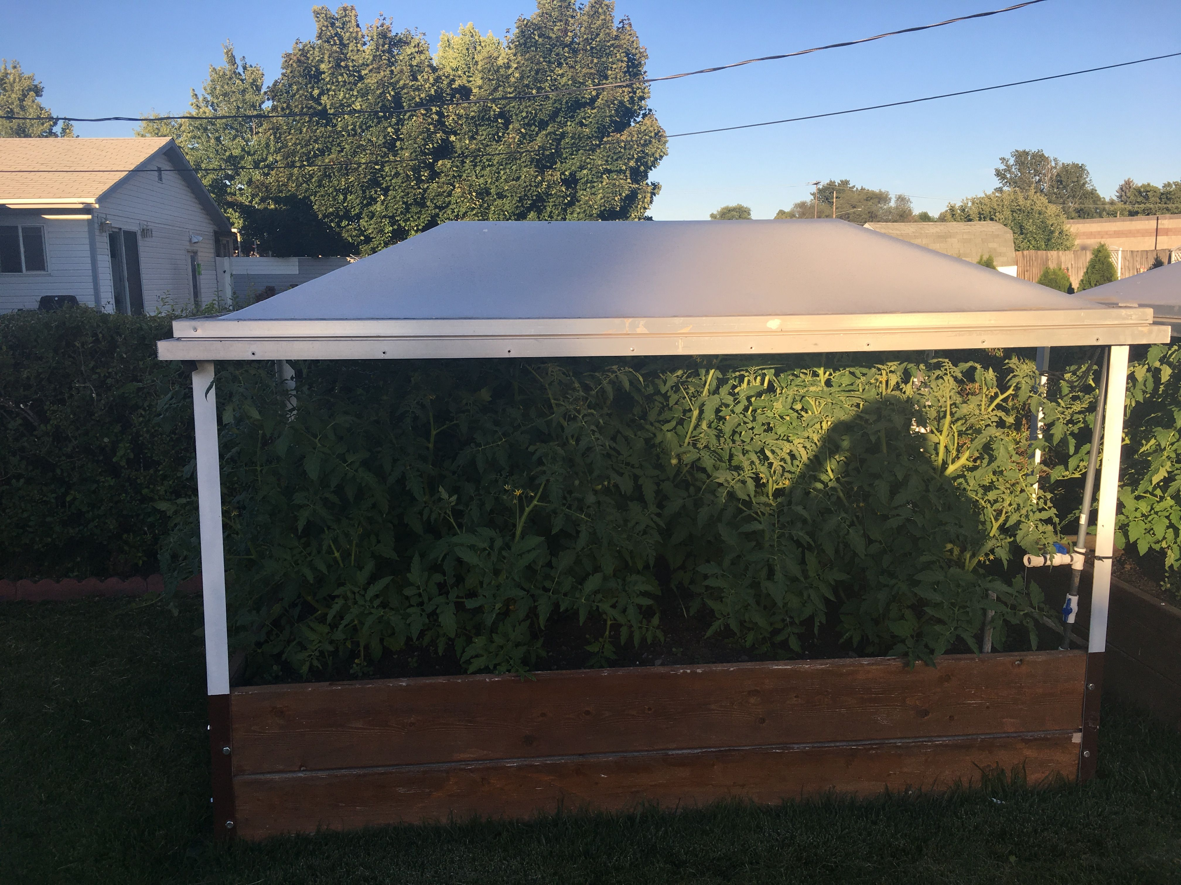 Raised Garden With Recycled Skylight And Misting System Tied Into The Sprinkler System Diy Garden Raised Garden Outdoor Decor