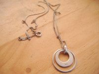 "New Listing Started Sterling silver two circle pendant 3/4""on 16""long chain in good condition £2.95"