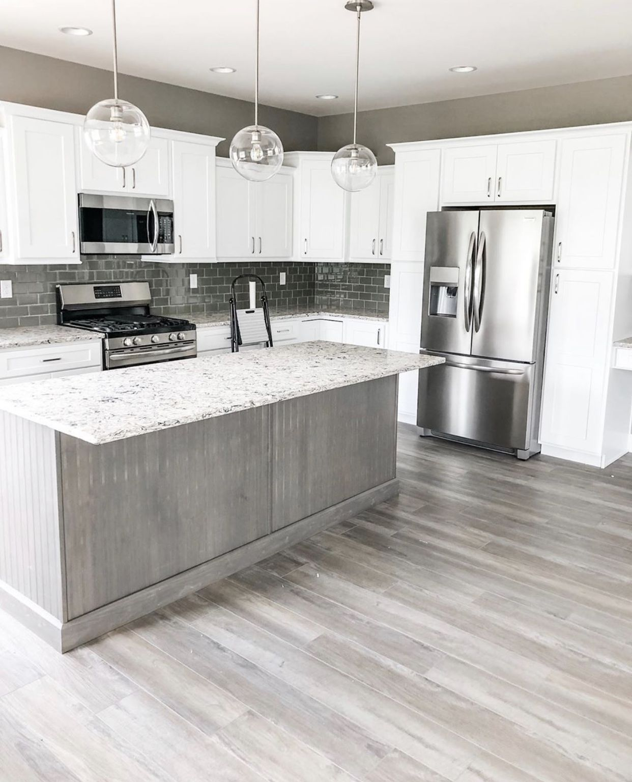 modern kitchen luxury vinyl plank flooring and glass subway tiled backsplash vinyl plank on kitchen remodel vinyl flooring id=17730