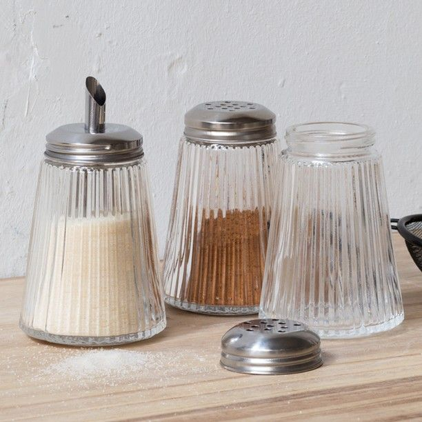Clara prefers sugar on her pancakes, but Anna goes for a dash of cinnamon. In shops now. Sugar and spice shakers, price DKK 9,90 / SEK 13,60 / NOK 14,40 / EUR 1,39 / ISK 269 / GBP 1.22
