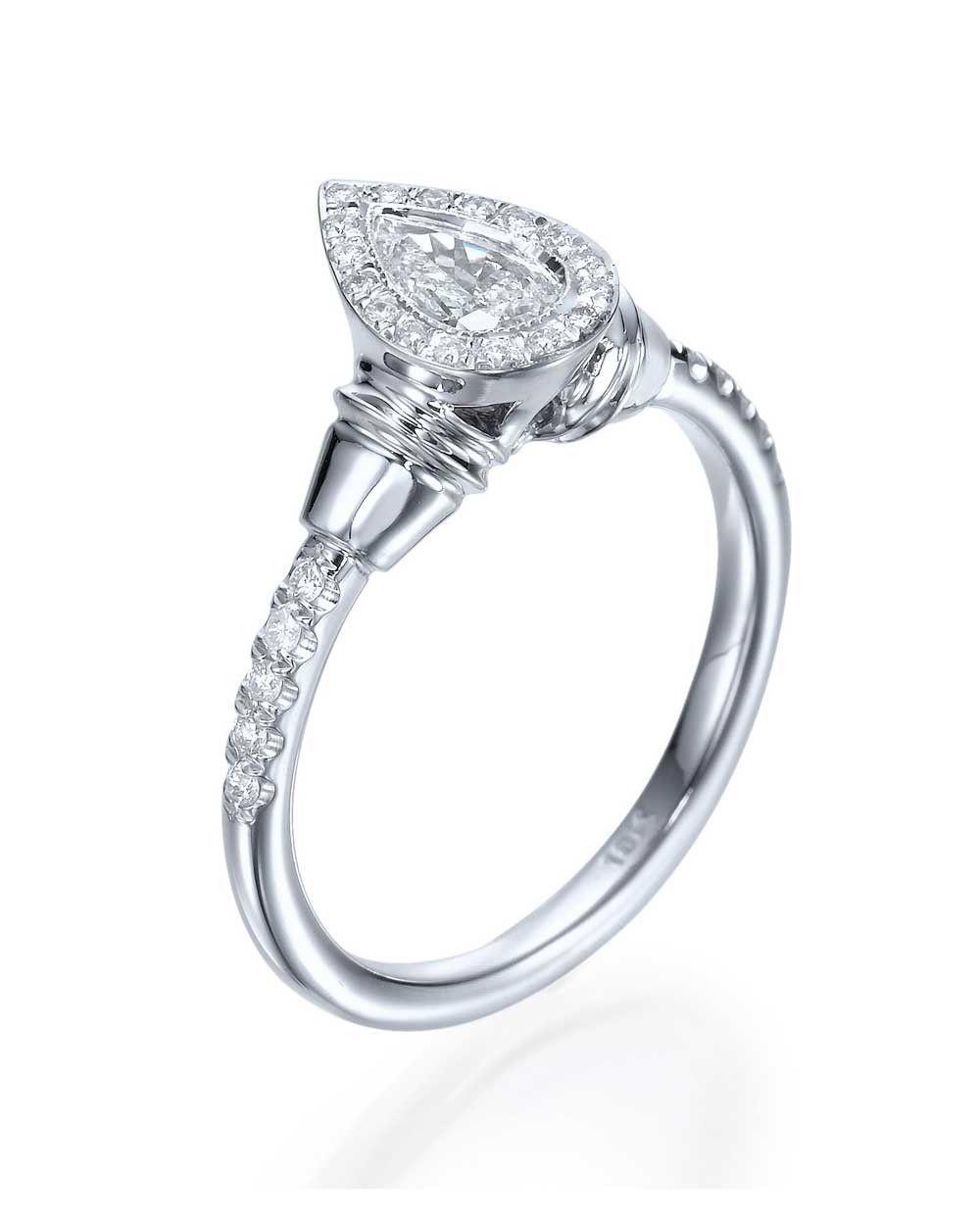 Halo pear shaped diamond antique vintage engagement ring vintage