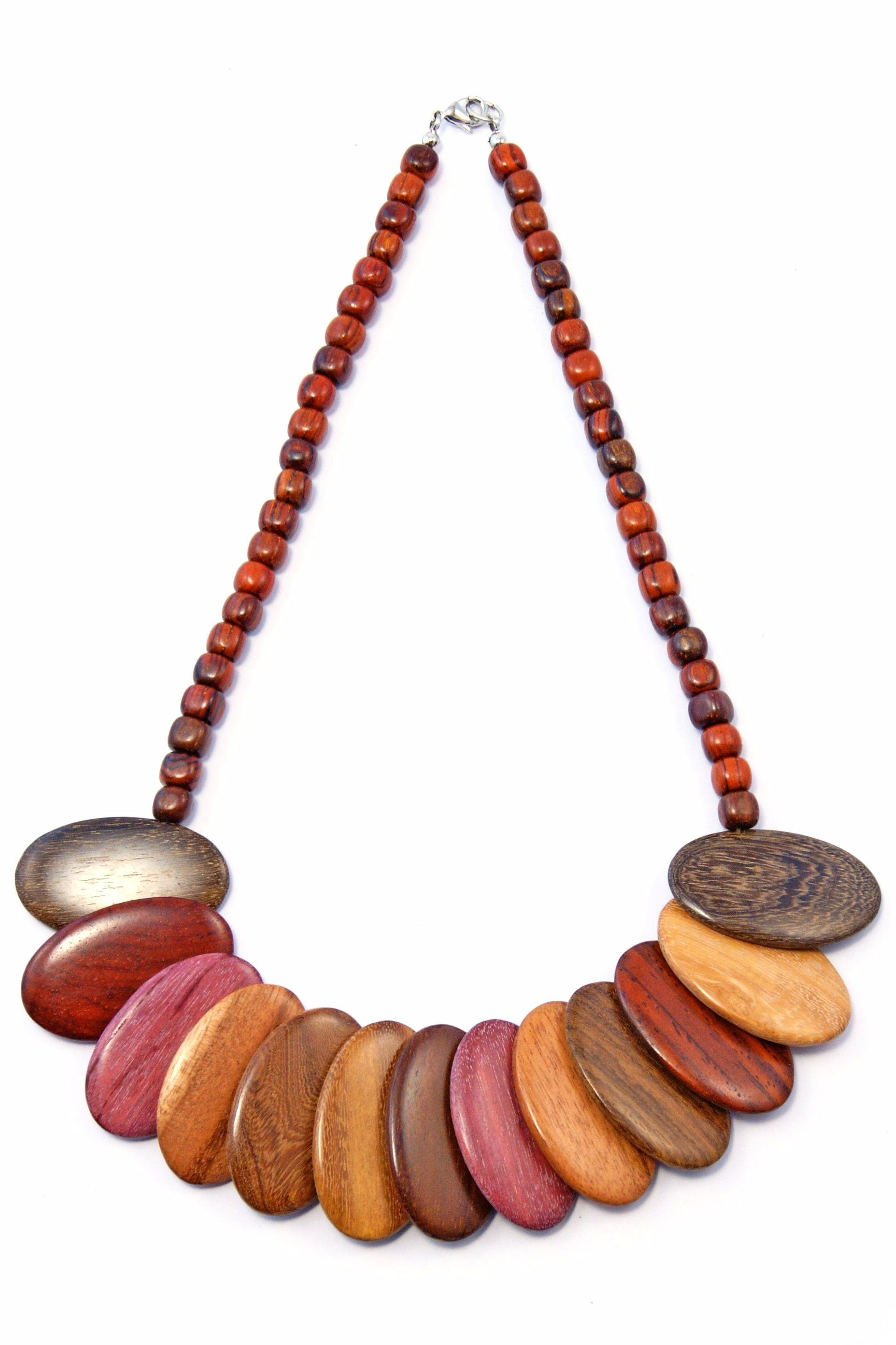 TICA SURF Unique tribal exotic wood necklace - Multicolor Oval Over - EE435 ~ Exotic wood tribal necklace ~ Polished multicolor beads ~ Made with genuine unstained natural woods ~ Handmade in Costa Rica Dimensions: 20 x 1.5 x 0.5 inches Color tone may vary EE435