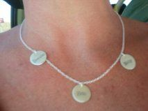3 attached charm necklace w/ kid's names on it. Sterling silver. BEST push present :) Blissliving.com