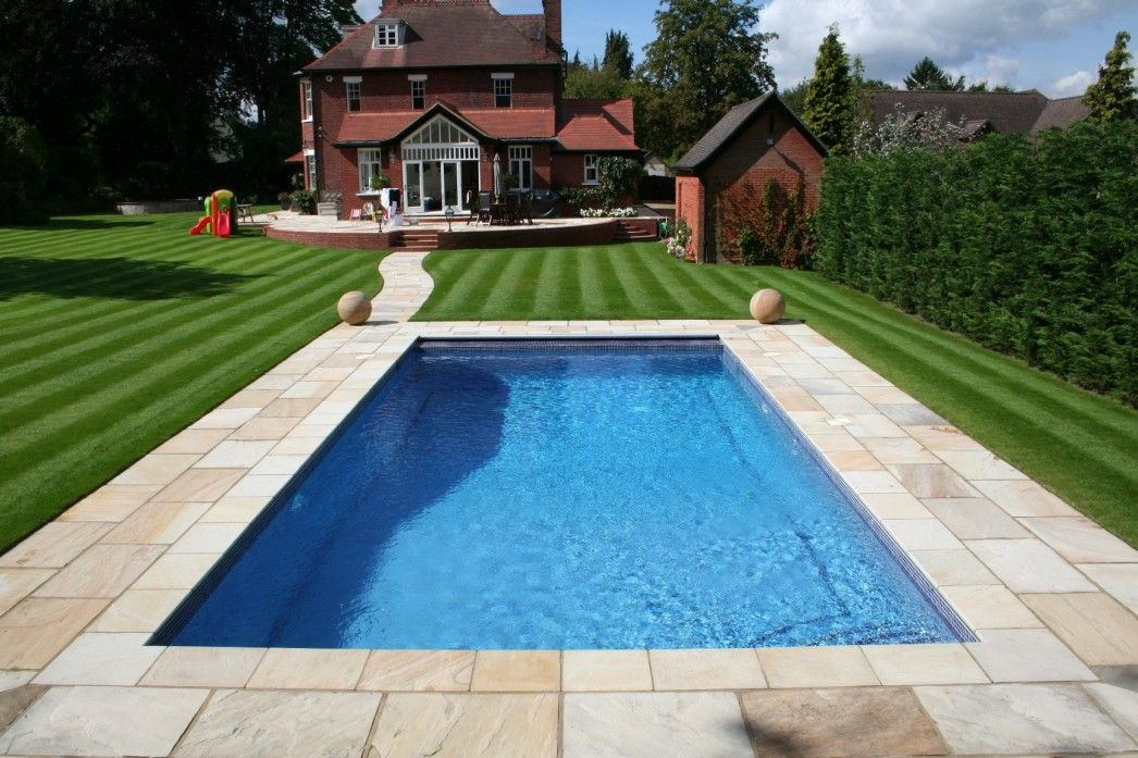 Pool With Stone Pavers With Grass Google Search Backyard Pool Designs Backyard Pool Swimming Pools Backyard