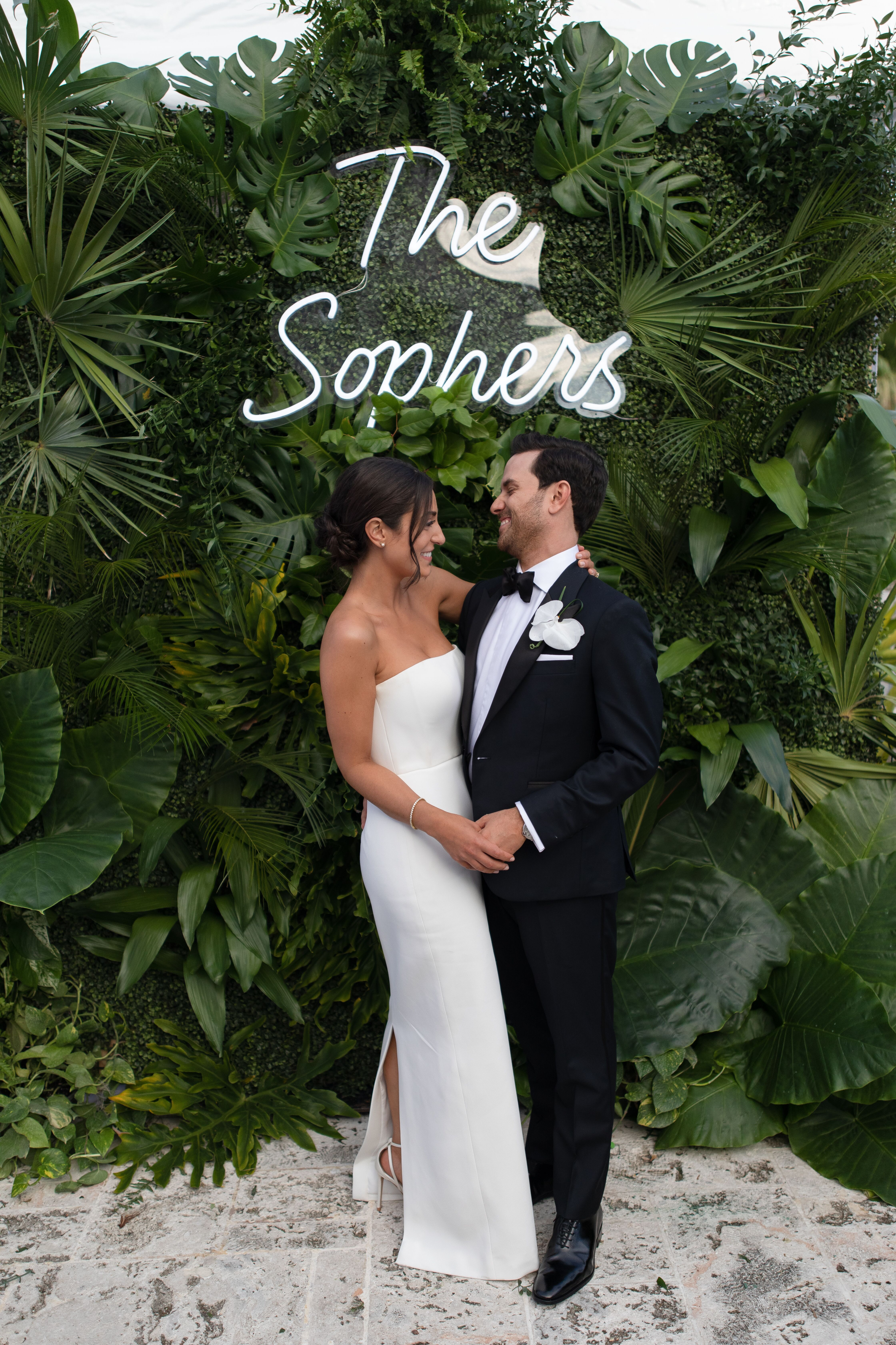 Custom neon wedding sign at ultimate Miami Beach bash at Fisher Island Club in Miami Beach, Florida. Brought to life by Florist and Planner- Ocean Flowers & Events and Photographer- Jonathan Scott Studio.