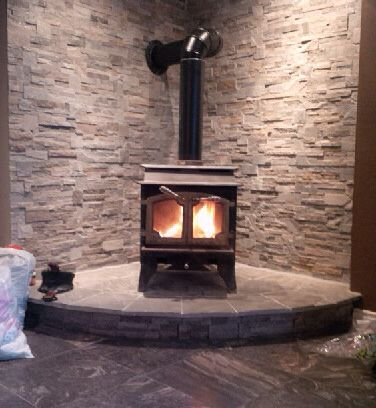 Stone And Old Wood Stove In Our Basement Mike Built And Installed We Love It Wood Stove Wood Stove Hearth Wood Stove Surround