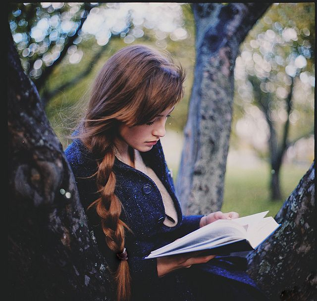 I was never this cute, but I spent my childhood reading in my grandparents' birches or under their neighbor's willow or...