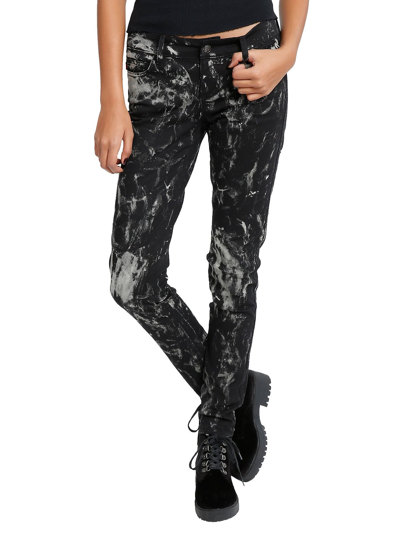 """<p>Black skinny jeans are a must. And these with a bleach splatter wash are the perfect addition to your collection.</p>  <ul> <li>10"""" leg opening</li> <li>97% cotton; 3% spandex</li> <li>Wash cold; dry low</li> <li>Imported</li> </ul>"""