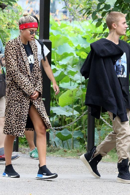 Sofia Richie wearing Adidas Nmd City Sock Primekit Core Black Sneakers and  Dsquared2 Vanessa Coat