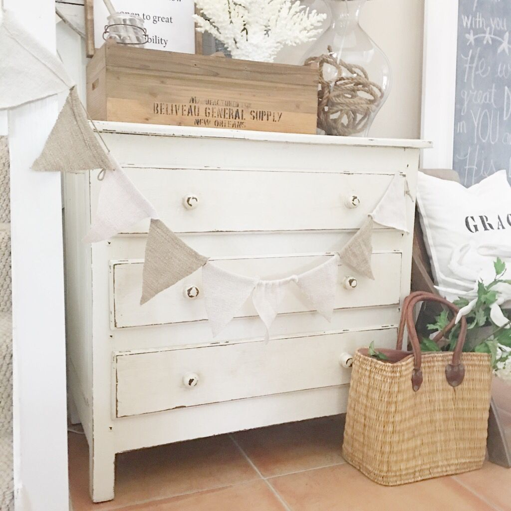 white dresser, bunting.