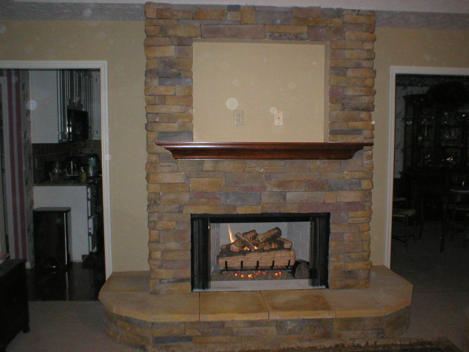 Stacked Stone Fireplace Living Room With Magnussen Lybrook Coffee