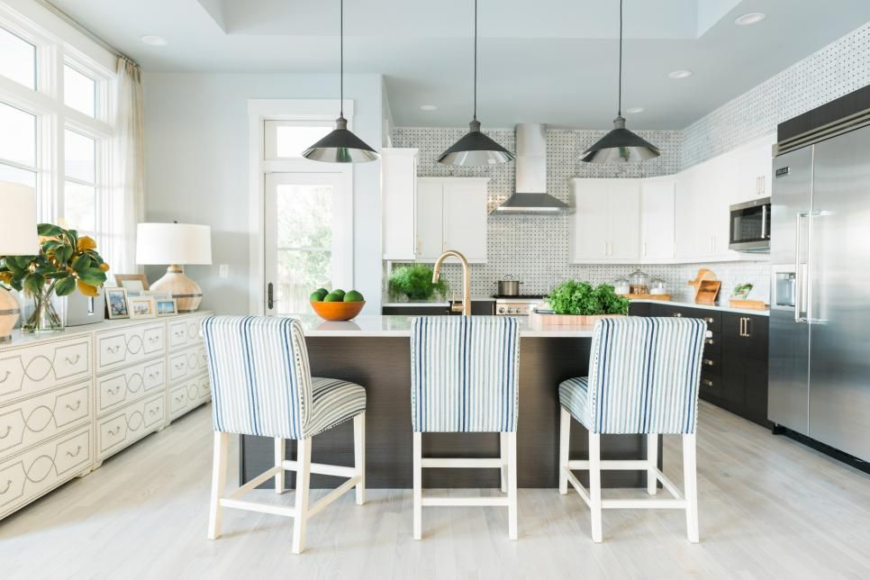 Kitchen with thomas counter stools by ethan allen in the remodeled hgtv dream home beach house genius design of using two dressers under the windows