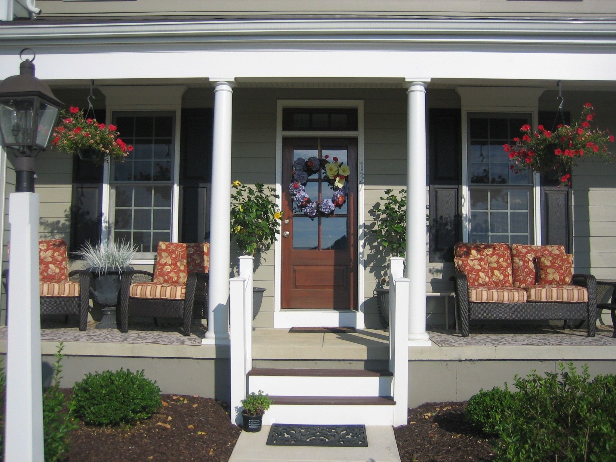 Gorgeous front porch furniture with colorful back seat Outside veranda designs
