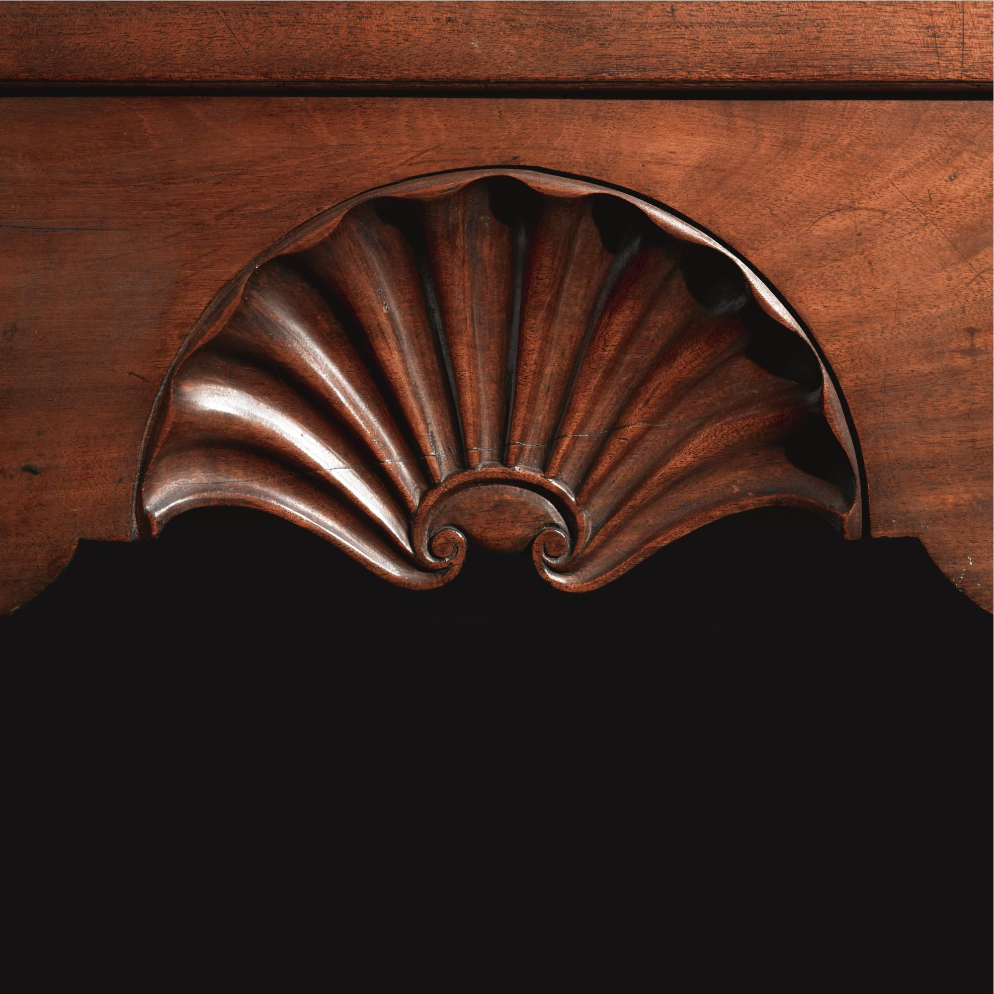 An important queen anne shell carved and figured mahogany dressing