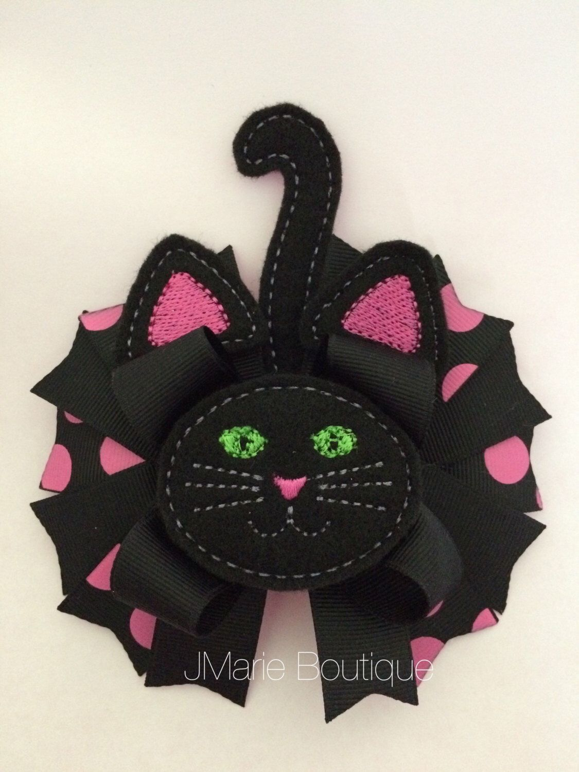 A personal favorite from my Etsy shop https://www.etsy.com/listing/469832093/black-cat-hair-bow-halloween-cat-blsck